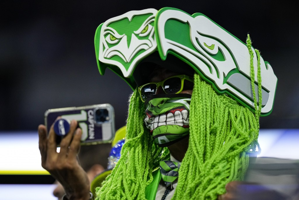 A Seattle Seahawks fans takes a photo before an NFL football game between the Seattle Seahawks and Indianapolis Colts in Indianapolis, Sunday, Sept. 1...