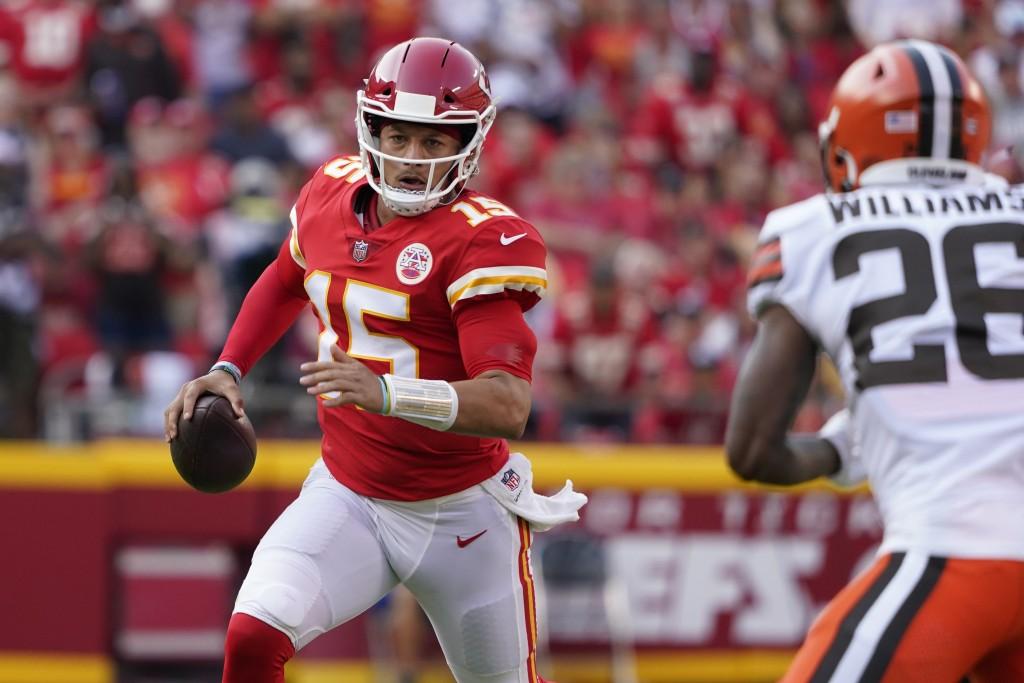 Kansas City Chiefs quarterback Patrick Mahomes (15) scrambles as Cleveland Browns cornerback Greedy Williams (26) defends during the second half of an...