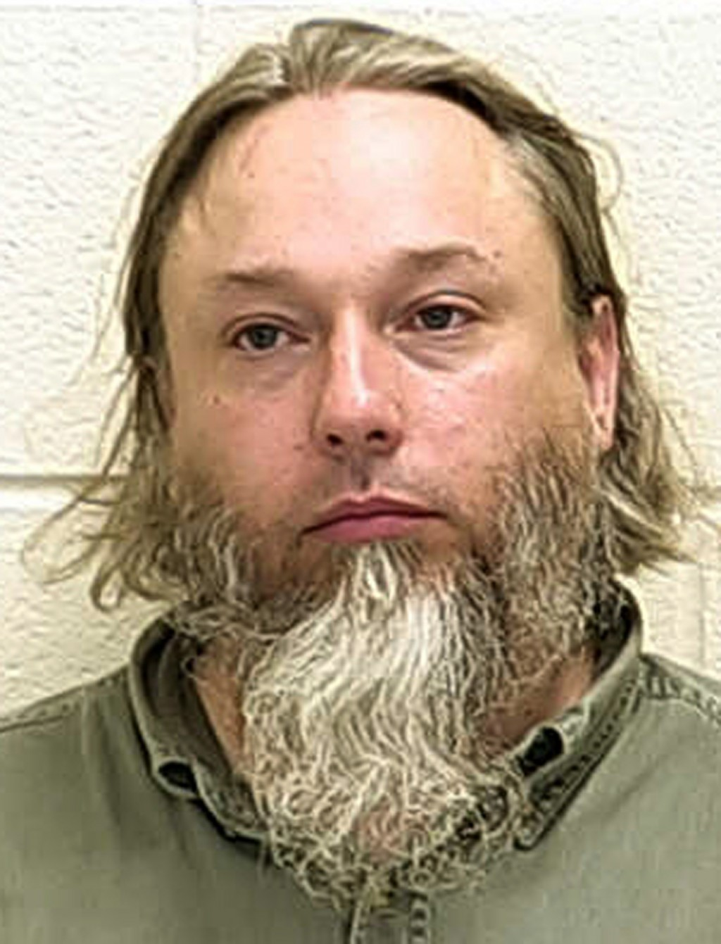 FILE - This undated file photo provided by The Ford County Sheriff's Office in Paxton, Ill., shows Michael Hari, a militia leader convicted of master...