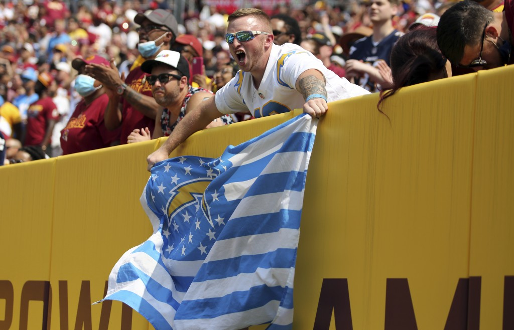 Los Angeles Chargers fans celebrate during an NFL football game against the Washington Football Team, Sunday, Sept. 12, 2021 in Landover, Md. (AP Phot...