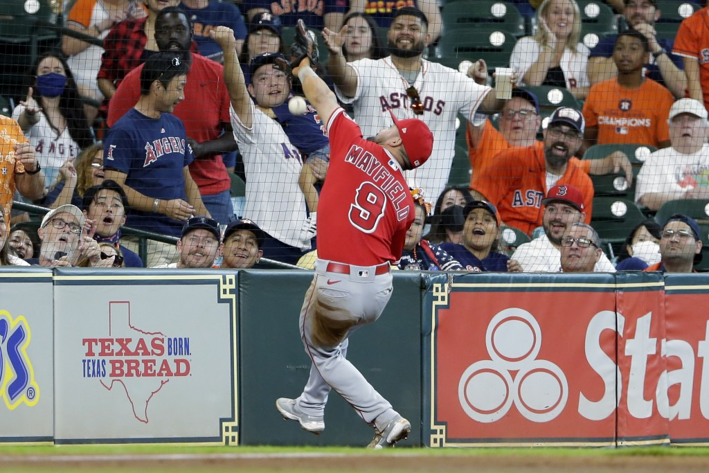 Los Angeles Angels third baseman Jack Mayfield (9) misses a catch at the net on the foul ball hit by Houston Astros' Kyle Tucker during the third inni...