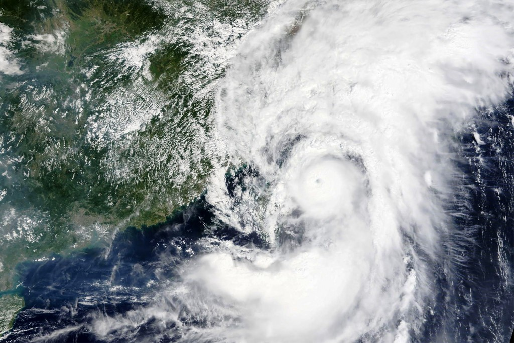 This Sunday, Sept, 12, 2021, satellite image released by NASA shows Typhoon Chanthu moving over Taiwan. Chanthu drenched Taiwan with up to 5 inches (1...