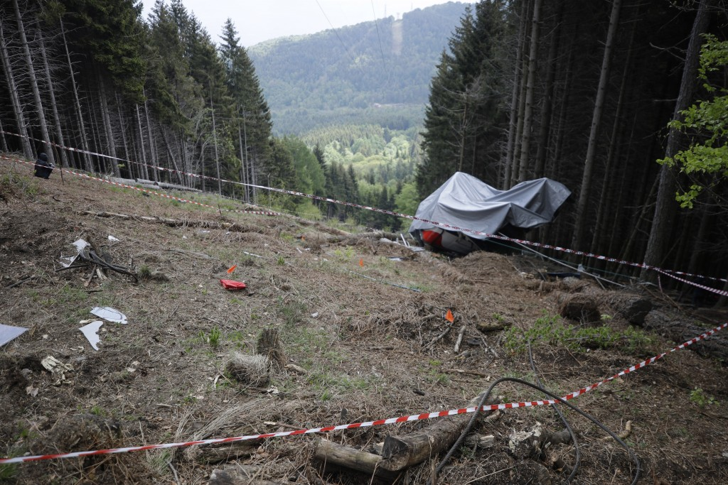 FILE - In this May 26, 2021 file photo, the wreckage of a cable car after it collapsed near the summit of the Stresa-Mottarone line in the Piedmont re...