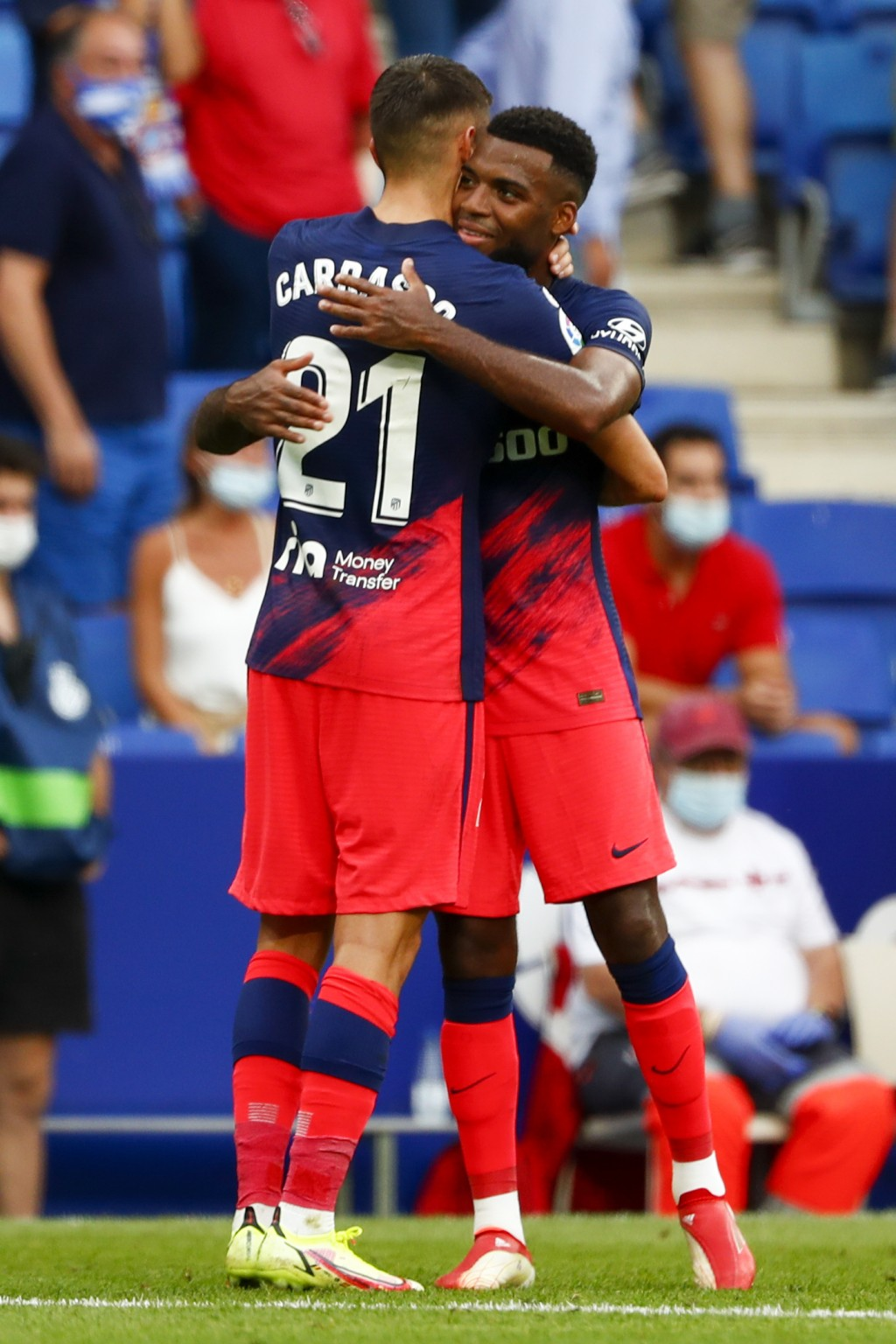 Atletico Madrid's Thomas Lemar, right, celebrates with his teammate Atletico Madrid's Yannick Carrasco after scoring his side's second goal during the...