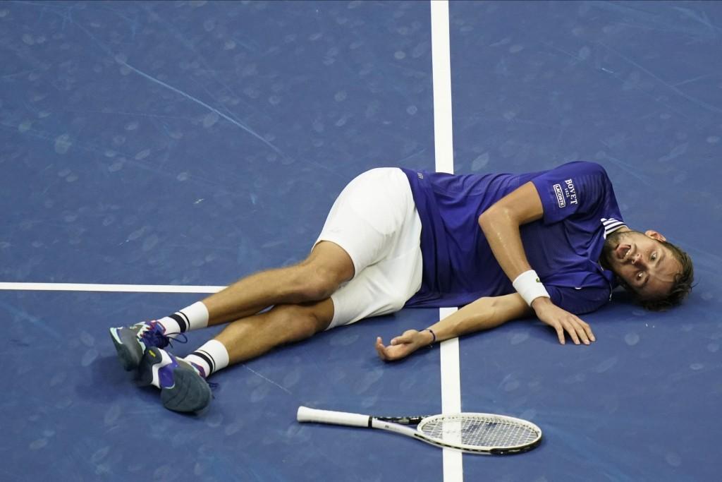 Daniil Medvedev, of Russia, reacts on the court after defeating Novak Djokovic, of Serbia, during the men's singles final of the US Open tennis champi...