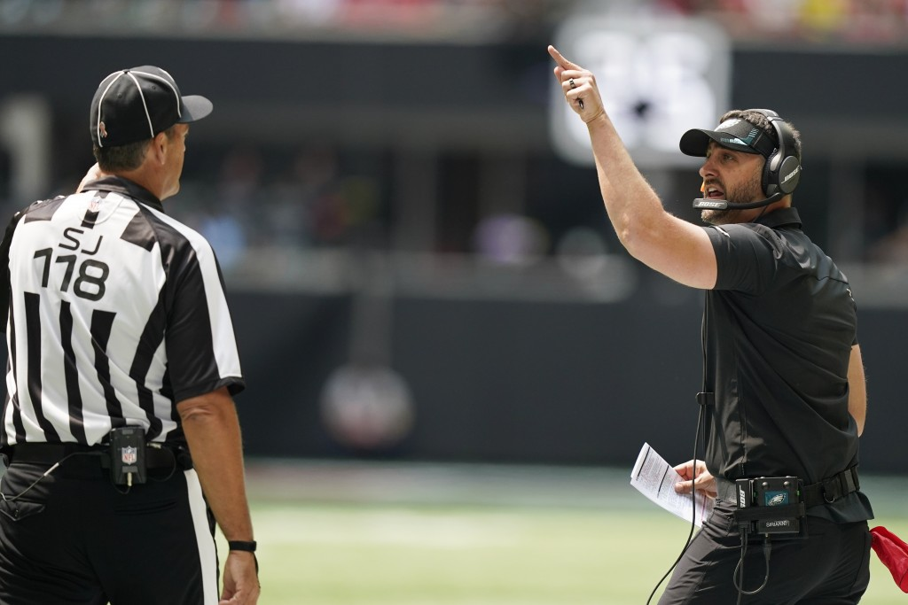 Philadelphia Eagles head coach Nick Sirianni speaks to an offical during the first half of an NFL football game between the Atlanta Falcons and the Ph...