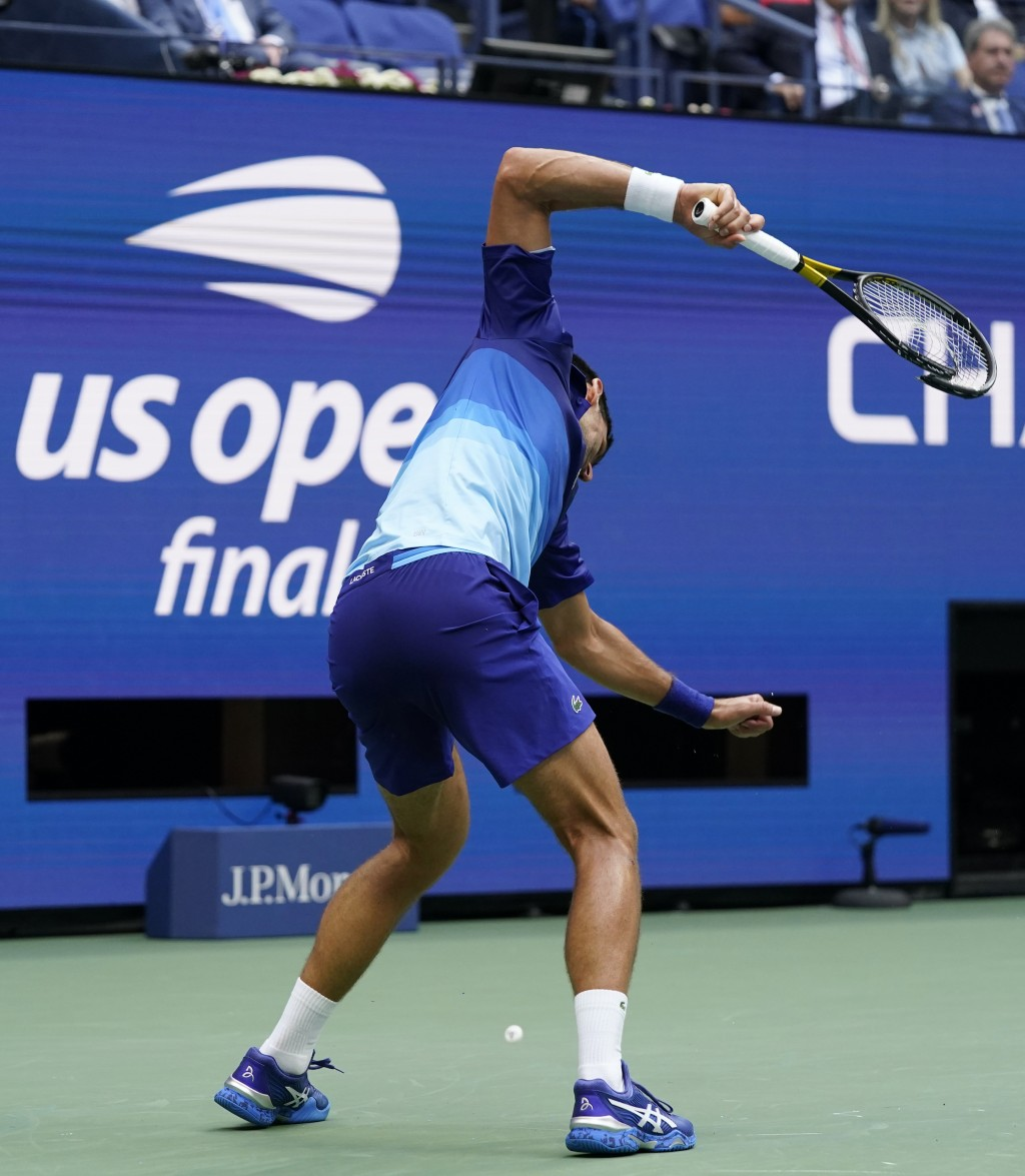 Novak Djokovic, of Serbia, smashes his racket after losing a point to Daniil Medvedev, of Russia, during the men's singles final of the US Open tennis...