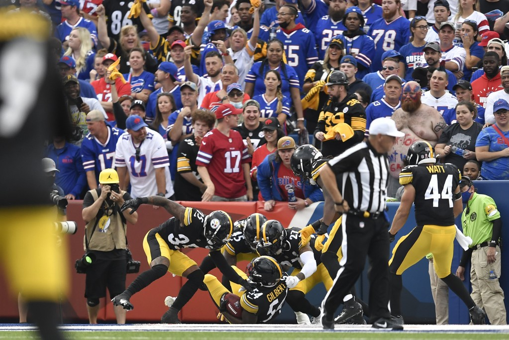 Pittsburgh Steelers linebacker Ulysees Gilbert (54) celebrates with teammates as he lies in the end zone after returning a blocked punt for a touchdow...