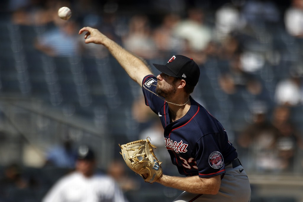 Minnesota Twins pitcher John Gant delivers to the New York Yankees during the first inning of a baseball game on Monday, Sept. 13, 2021, in New York. ...