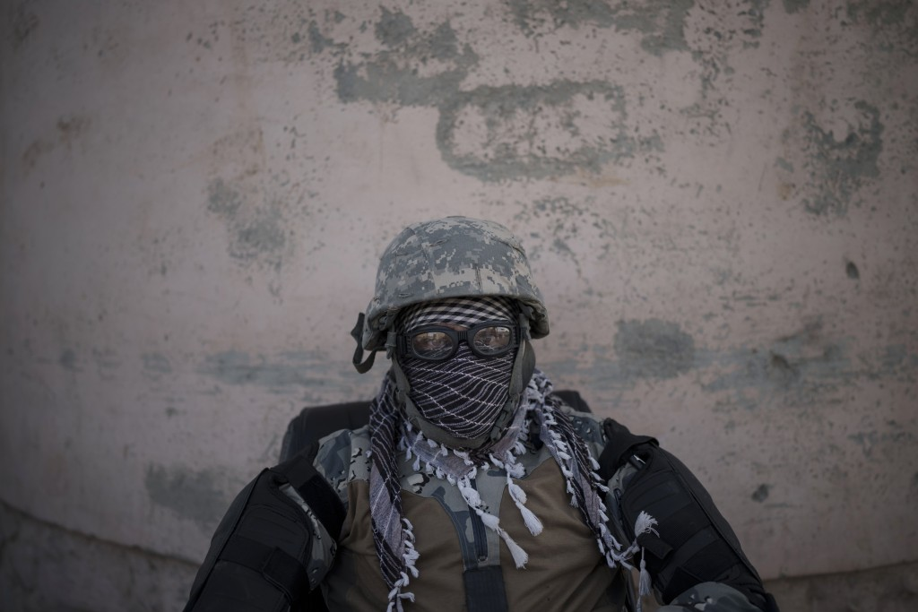 A Taliban fighter guards the entrance of the Pul-e-Charkhi prison in Kabul, Afghanistan, Monday, Sept. 13, 2021. Pul-e-Charkhi was previously the main...
