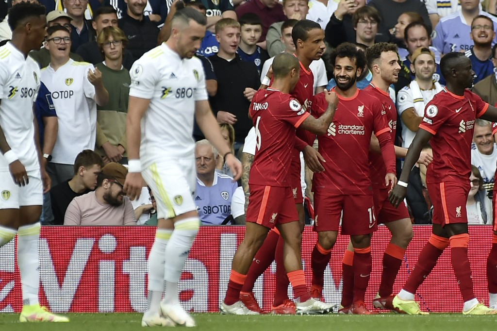 Liverpool's Mohamed Salah, 3rd right, celebrates after scoring the opening goal during the English Premier League soccer match between Leeds United an...