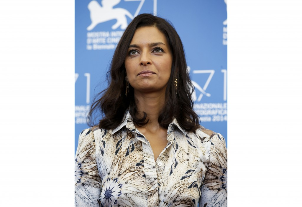 FILE - Jhumpa Lahiri poses during a photo call at the 71st edition of the Venice Film Festival in Venice, Italy, on Aug. 27, 2014.  Princeton Universi...