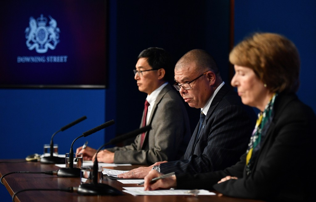 Chair of the Joint Committee on Vaccination and Immunisation (JCVI) Professor Wei Shen Lim, left, Britain's Deputy Chief Medical Officer for England J...