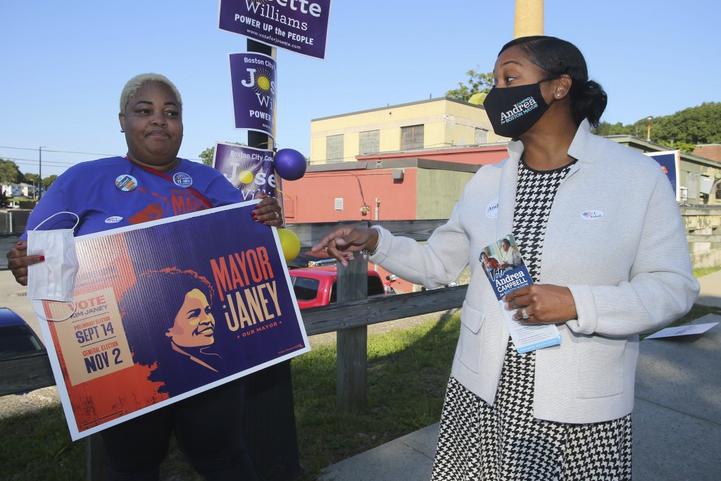 Boston mayoral candidate Andrea Campbell, right, talks with Aisha Miller, a supporter of Mayor Kim Janey, outside the Groveland Community Room in Bost...
