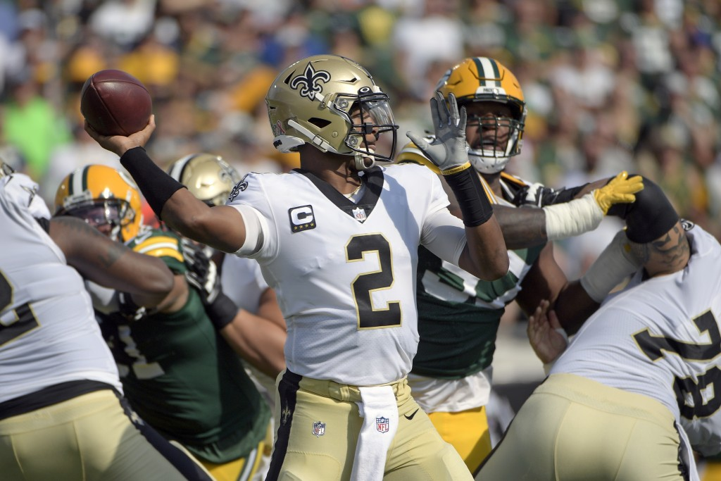 New Orleans Saints quarterback Jameis Winston (2) throws a pass during the first half of an NFL football game against the Green Bay Packers, Sunday, S...