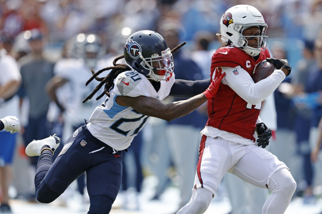 Arizona Cardinals wide receiver DeAndre Hopkins (10) is pushed out of bounds by Tennessee Titans cornerback Jackrabbit Jenkins (20) in the first half ...