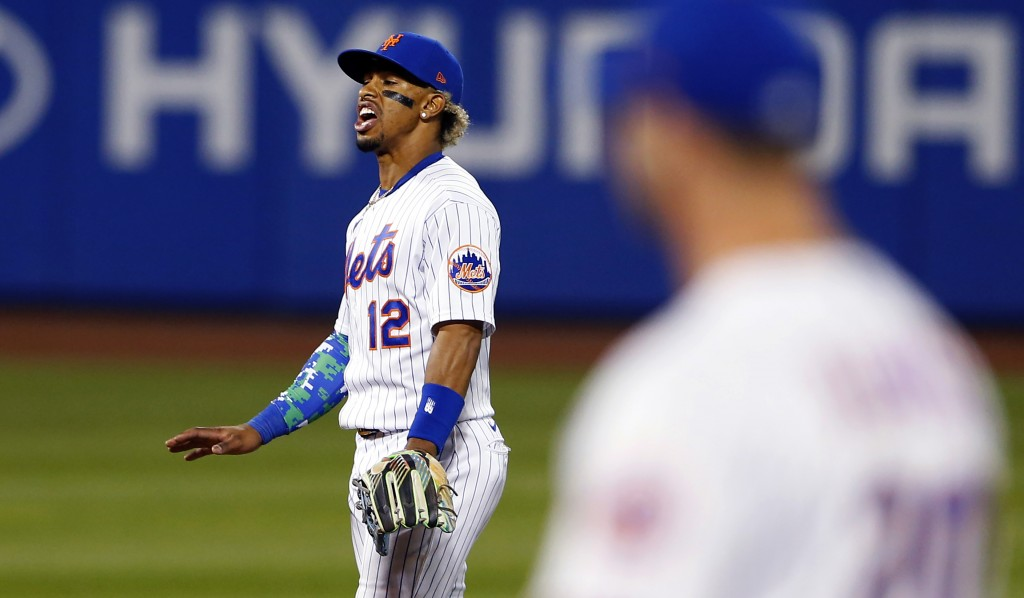 New York Mets' Francisco Lindor (12) reacts after New York Yankees' Giancarlo Stanton (27) hit a home run in the seventh inning of a baseball game, Su...