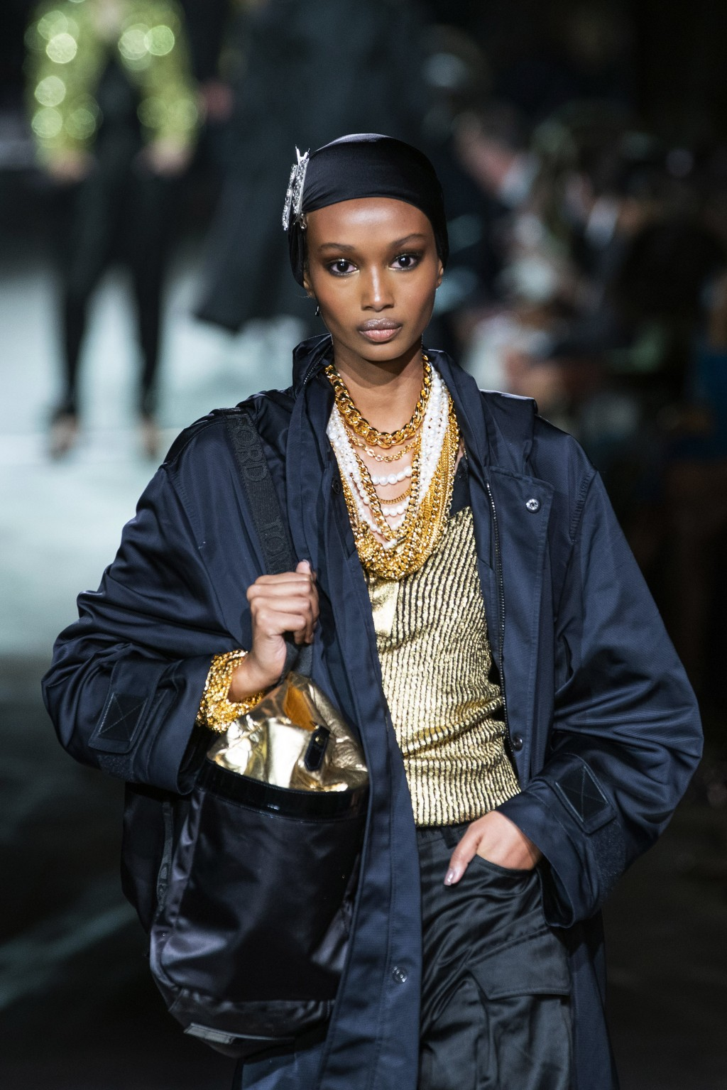 A model walks the runway at the Tom Ford spring/summer 2022 fashion show in the Lincoln Center during New York Fashion Week on Sunday, Sept. 12, 2021....