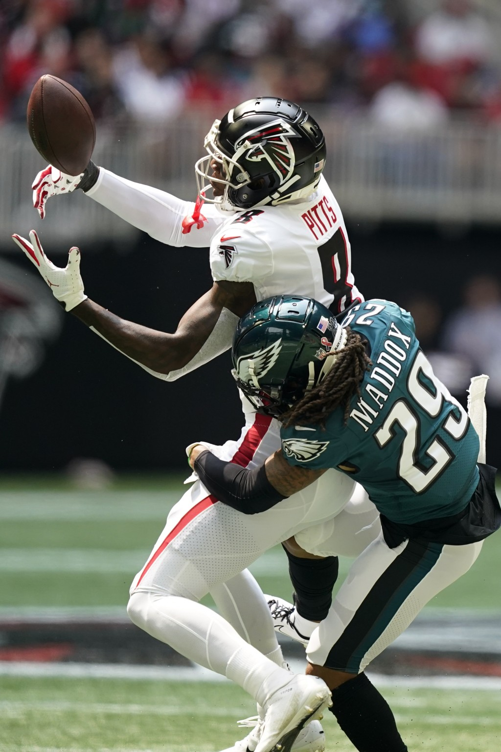 Atlanta Falcons tight end Kyle Pitts (8) misses the catch against Philadelphia Eagles free safety Avonte Maddox (29) during the first half of an NFL f...