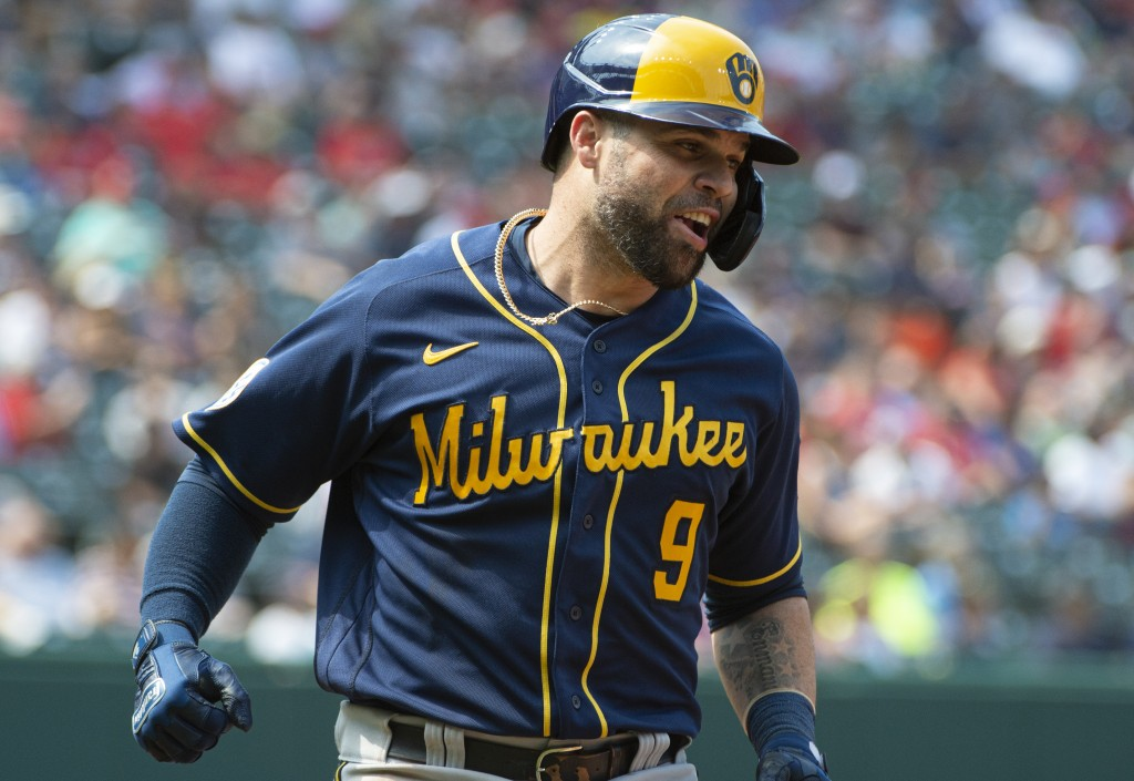 Milwaukee Brewers' Manny Pina celebrates after hitting a two-run home run off Cleveland Indians starting pitcher Aaron Civale during the second inning...