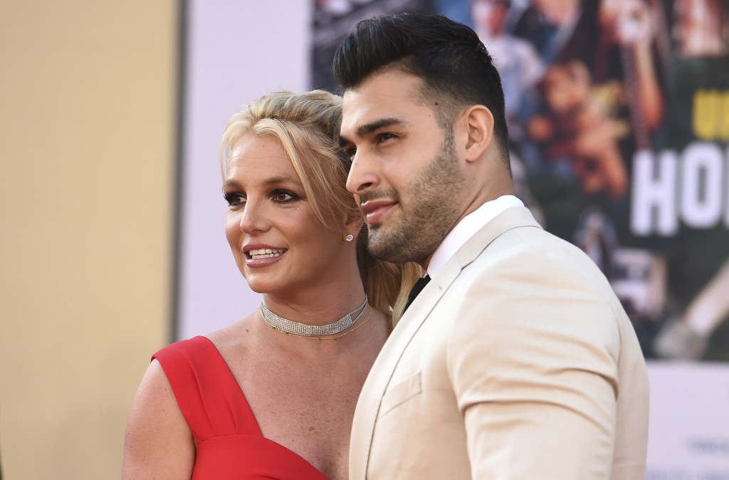 """Britney Spears and Sam Asghari arrive at the Los Angeles premiere of """"Once Upon a Time in Hollywood,"""" at the TCL Chinese Theatre, Monday, July 22, 201..."""