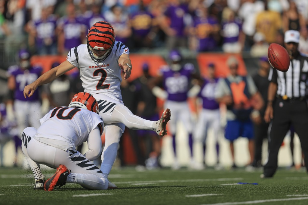 Cincinnati Bengals kicker Evan McPherson (2) hits a field goal to defeat the Minnesota Vikings during overtime of an NFL football game, Sunday, Sept. ...