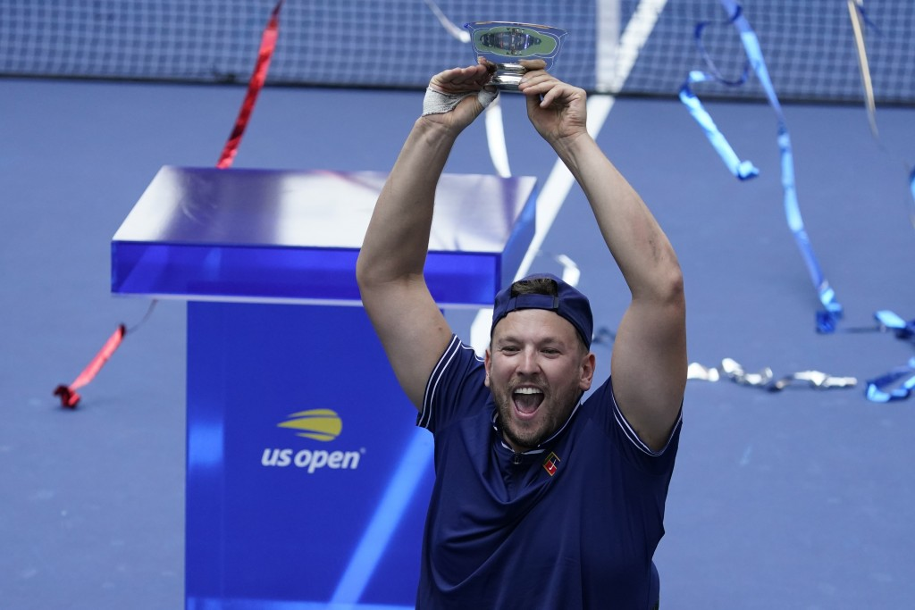 Dylan Alcott, of Australia, celebrates after defeating Niels Vink, of the Netherlands, during the men's wheelchair quad singles final at the U.S. Open...