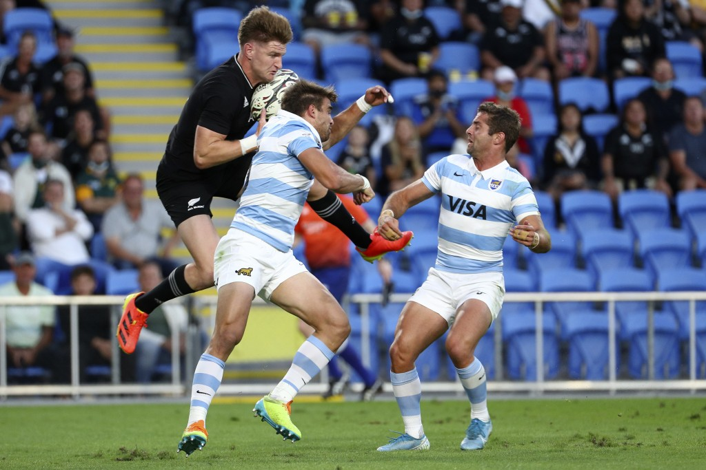 New Zealand's Jordie Barrett, left, competes for the ball against Argentina's Juan Cruz Mallia during their Rugby Championship match on Sunday, Sept. ...
