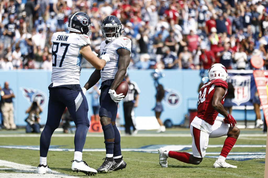 Tennessee Titans wide receiver A.J. Brown, center, is congratulated by tight end Geoff Swaim (87) after Brown scored a touchdown against the Arizona C...