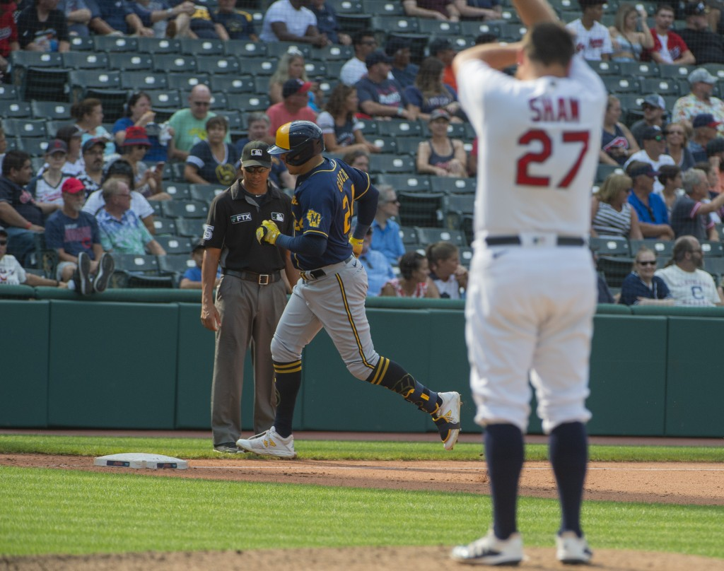 Milwaukee Brewers' Avisail Garcia, center, rounds the bases after hitting a three-run home run off Cleveland Indians relief pitcher Bryan Shaw, right,...