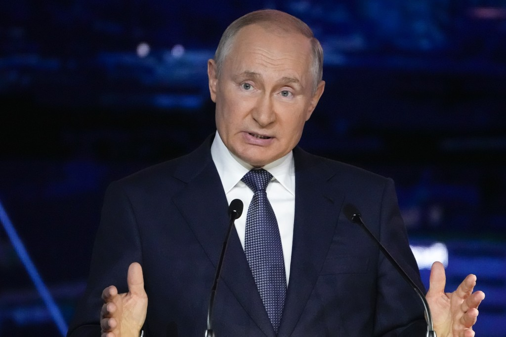 FILE - In this Sept. 3, 2021, file photo, Russian President Vladimir Putin gestures as he delivers his speech during a plenary session at the Eastern ...