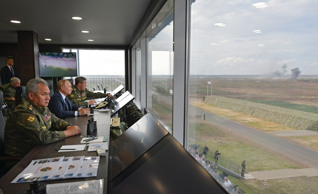 Russian President Vladimir Putin, center, Russian Defense Minister Sergei Shoigu, left, and Russian General Staff Valery Gerasimov, right, watch the j...