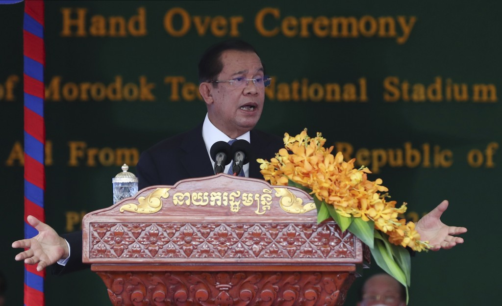 Cambodian Prime Minister Hun Sen delivers a speech during a ceremony to hand over the Morodok Techo National Stadium, as it was handed over to the Cam...