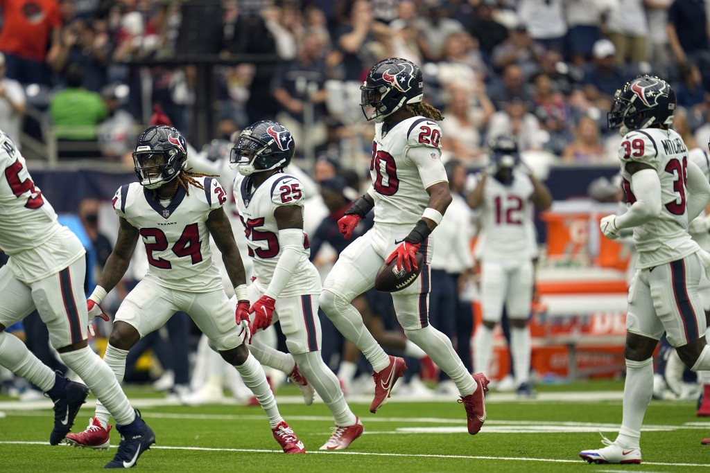 Houston Texans safety Justin Reid (20) celebrates after intercepting a pass against the Jacksonville Jaguars during the first half of an NFL football ...