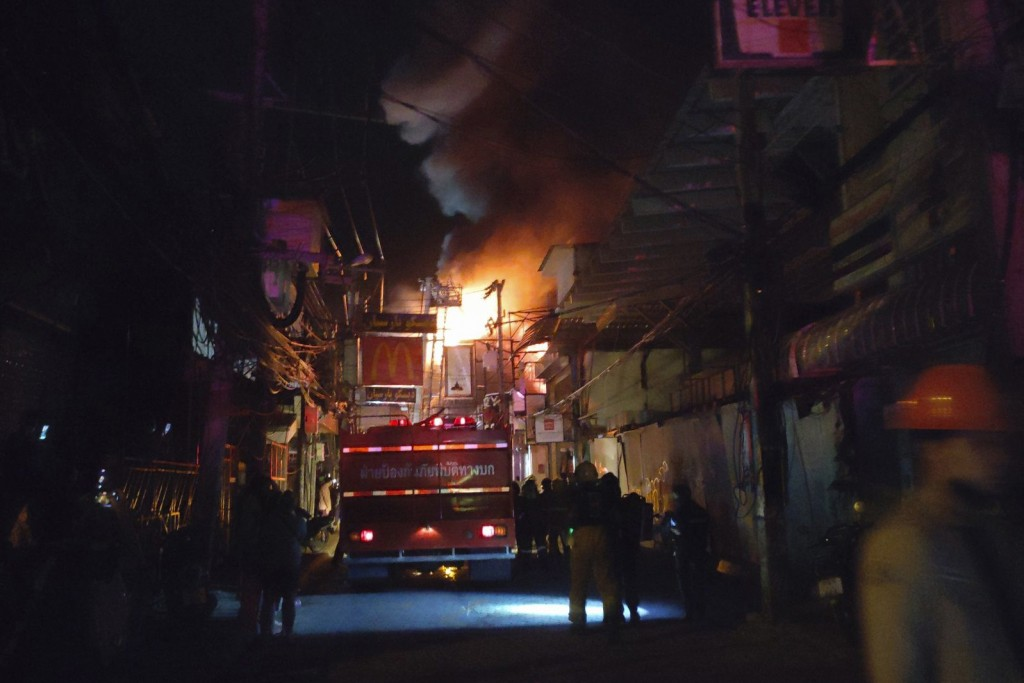 In this Sunday, Sept. 12, 2021, photo, firefighters work the scene of a structure fire at the Nashaa Club, Pattaya, Chonburi province, Thailand. The f...