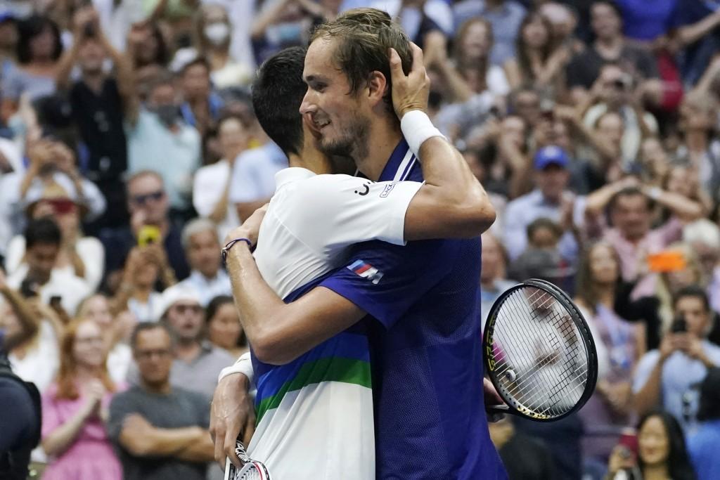 Daniil Medvedev, of Russia, hugs Novak Djokovic, of Serbia, after defeating Djokovic in the men's singles final of the US Open tennis championships, S...