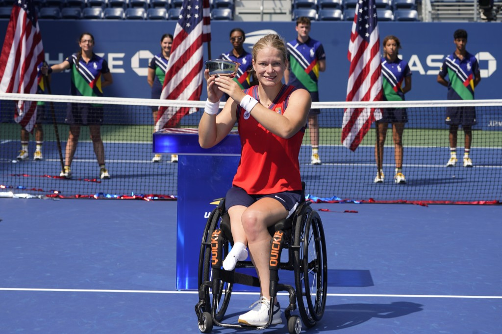 Diede De Groot, of the Netherlands, holds the championship trophy after her victory over Yui Kamiji, of Japan, in the women's wheelchair singles final...