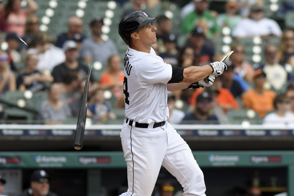 Detroit Tigers catcher Dustin Garneau breaks his bat as he hits a double against the Tampa Bay Rays in the third inning of a baseball game, Sunday, Se...