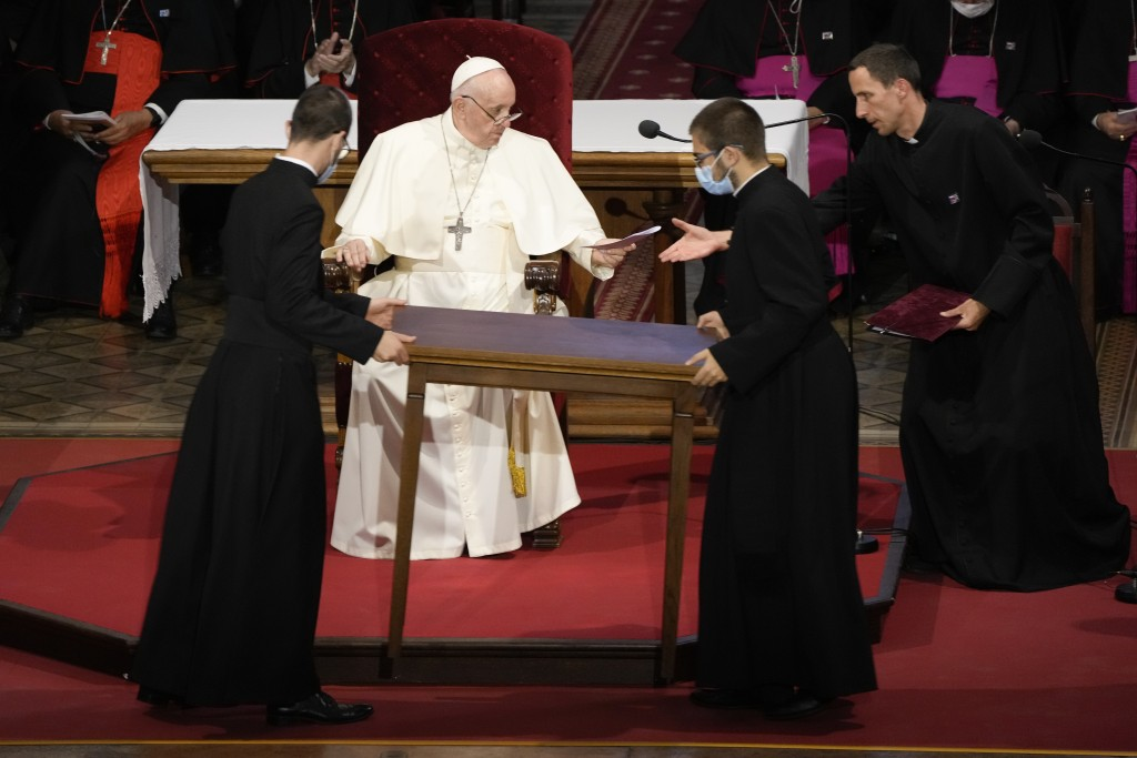 Priests carry a table in front of Pope Francis during a meeting with priests, religious men and women, seminarians and catechists, at the Cathedral of...