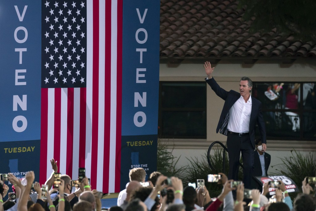 Supporters cheer California Gov. Gavin Newsom as he arrives at a rally ahead of the California gubernatorial recall election Monday, Sept. 13, 2021, i...