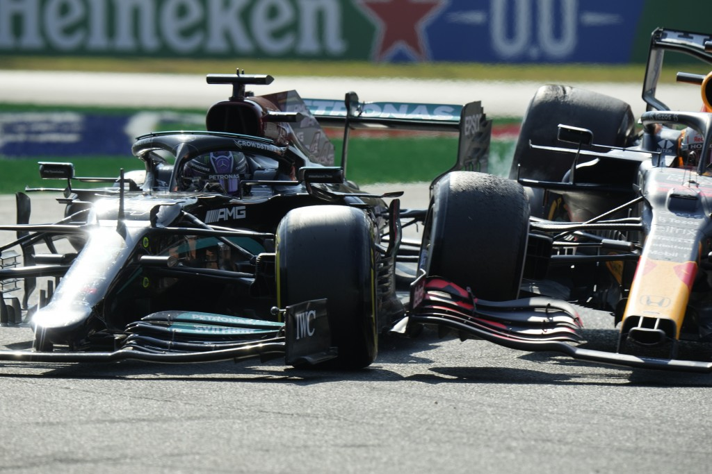 Mercedes driver Lewis Hamilton of Britain crashes with Red Bull driver Max Verstappen of the Netherlands during the Italian Formula One Grand Prix, at...
