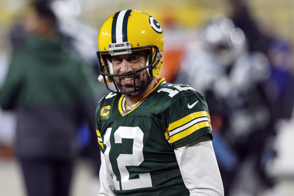 FILE - In this Dec 19. 2020, file photo, Green Bay Packers quarterback Aaron Rodgers (12) smiles before an NFL football game against the Carolina Pant...
