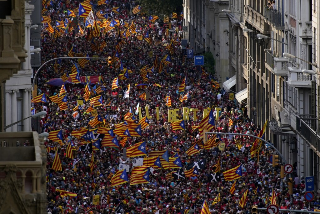 Demonstrators march during the Catalan National Day in Barcelona, Spain, Saturday, Sept. 11, 2021. Thousands of Catalans have rallied for independence...