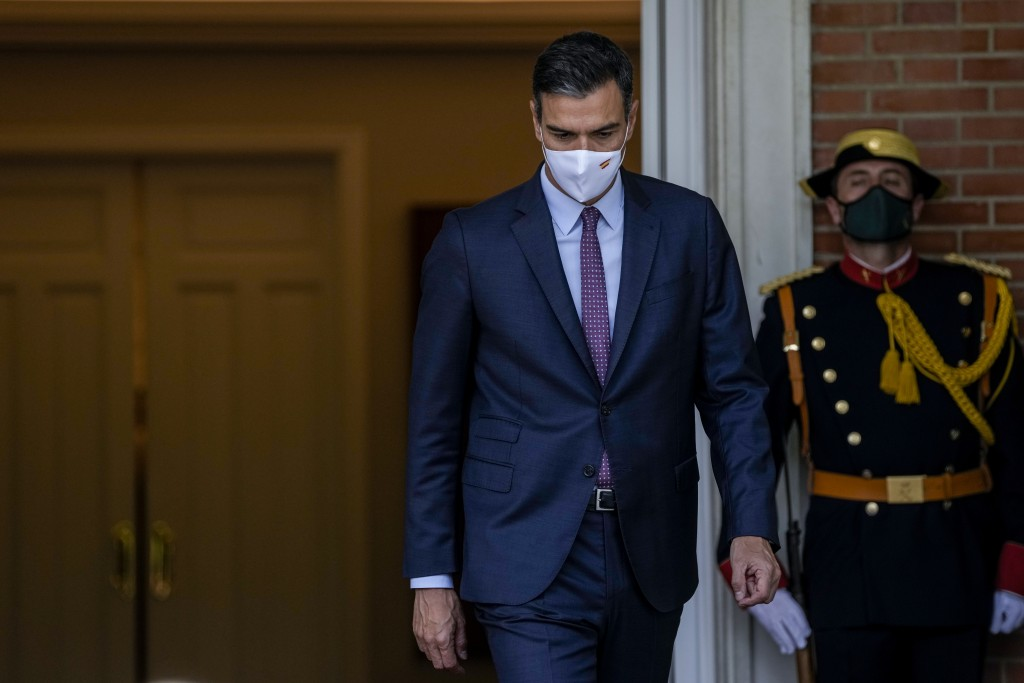 Spanish Prime Minister Pedro Sanchez walks prior to his meeting with Chilean President Sebastian Pinera at the Moncloa palace in Madrid, Spain, Tuesda...