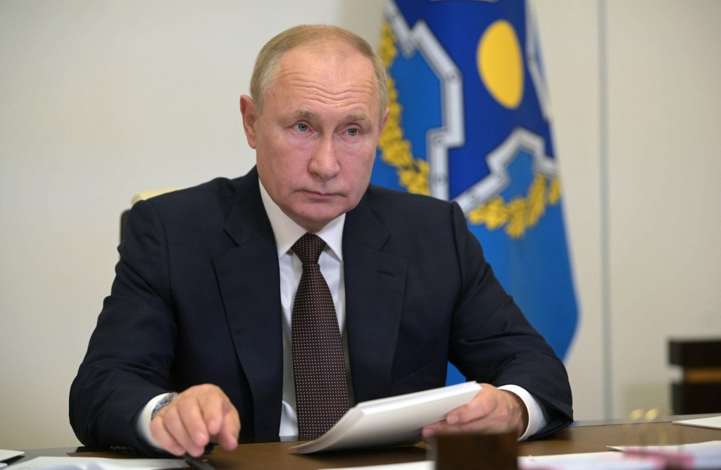Russia's President Vladimir Putin attends a meeting of the Collective Security Treaty Organization (CSTO) via video conference at the Novo-Ogaryovo re...