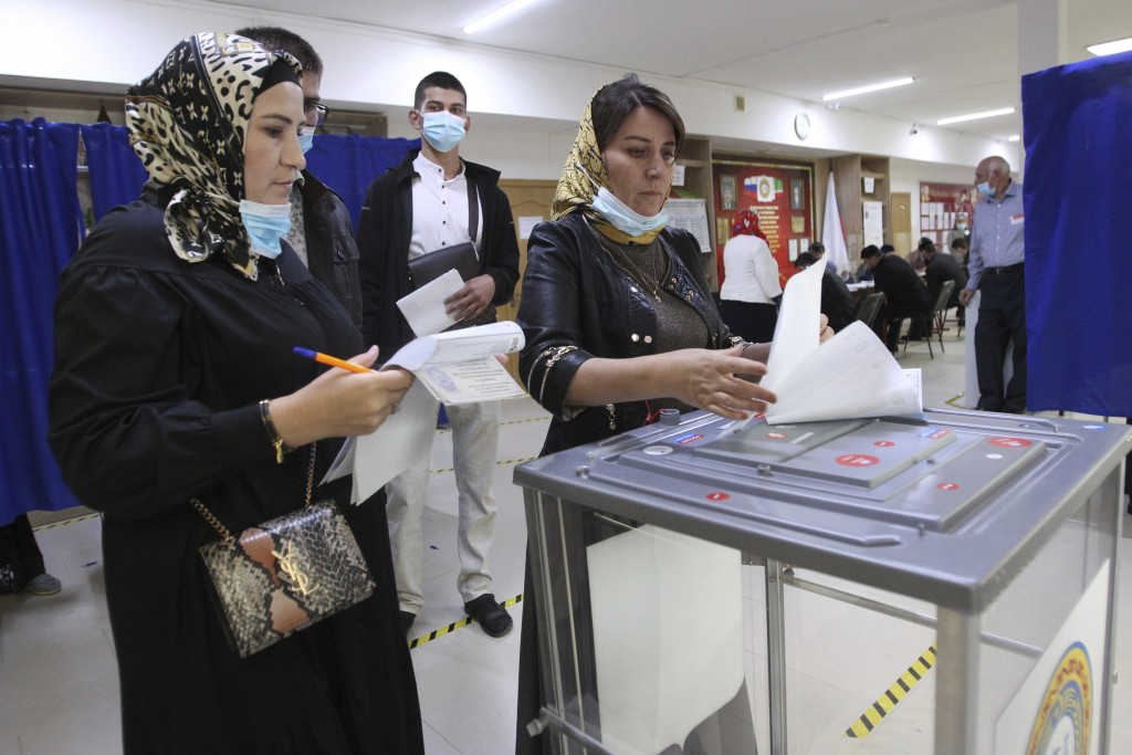 Chechen women cast their ballots at a polling station during the Parliamentary elections in Grozny, Russia, Friday, Sept. 17, 2021. Russia has begun t...