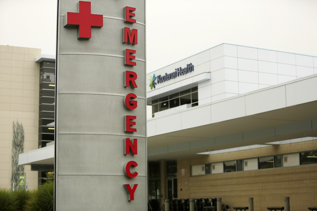 FILE - In this Sept. 10, 2021 file photo an emergency department sign is photographed at Kootenai Health, in Coeur d'Alene, Idaho. Idaho's public heal...