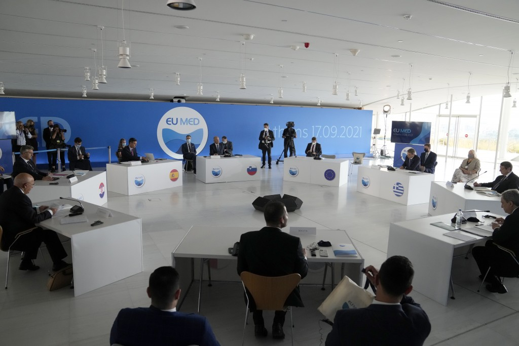 Participants attend the EUMED 9 summit at the Stavros Niarchos Foundation Cultural Center in Athens, Friday, Sept. 17, 2021. Nine European countries o...