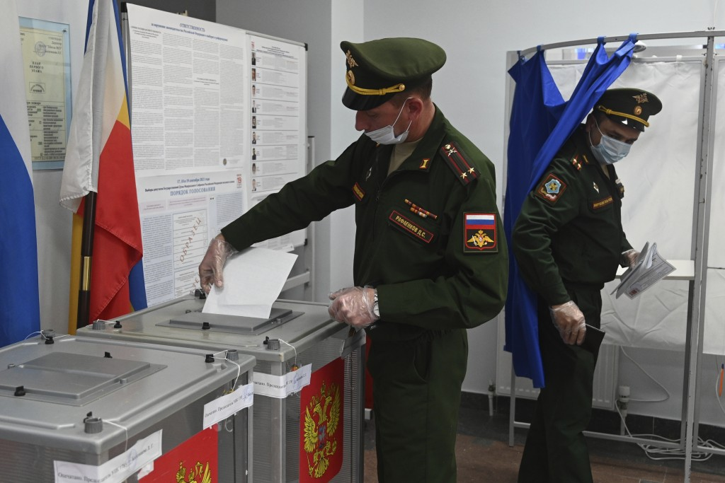 Russian officers vote at a polling station during the Parliamentary elections in Rostov-on-Don, Russia, Friday, Sept. 17, 2021. Russia has begun three...