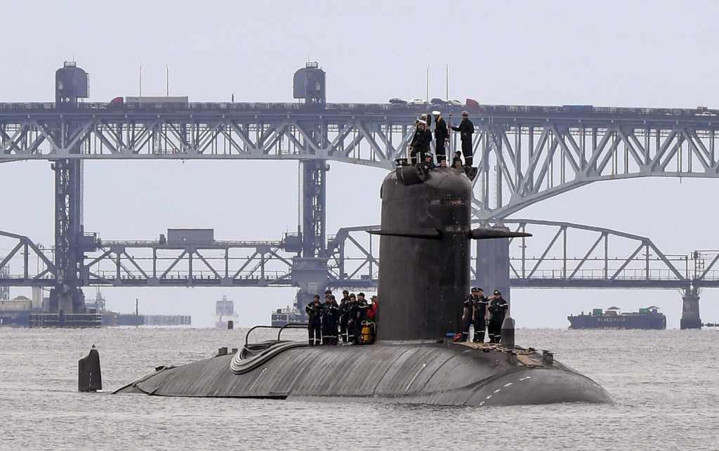 In this photo provided by U.S. Navy, French submarine FNS Amethyste (S605) transits the Thames River in preparation to arrive at Naval Submarine Base ...